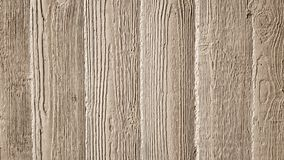 Gray concrete wall with wooden relief embossing Stock Images