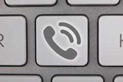 Gray Contact Us en el teclado Imagen de archivo libre de regalías