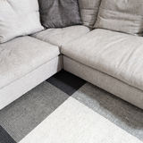 Gray corner sofa and carpet Royalty Free Stock Photography