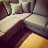 Gray corner sofa and wooden coffee table Royalty Free Stock Photography