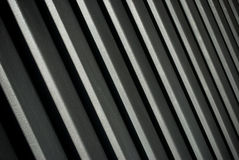 Gray corrugated metal sheet background. Diagonal closeup of regular corrugated metal stock photo