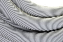Gray corrugated pipe. Corrugated pipe for electrical installations Royalty Free Stock Photos