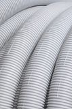 Gray corrugated plastic pipe. For electrical installations Stock Photos