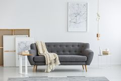 Gray couch in modern room Stock Image