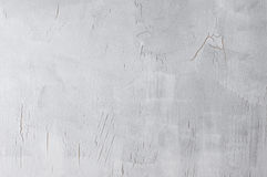 Gray cracked background. Painted light gray stained cracked canvas texture as background. Photo Stock Image