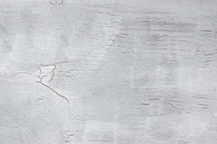 Gray cracked background. Painted light gray stained cracked canvas texture as background. Photo Stock Photo