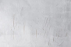 Gray cracked background. Painted light gray stained cracked canvas texture as background. Photo Royalty Free Stock Photo