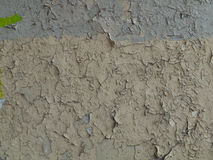 Gray cracked paint on an old wall Royalty Free Stock Photography