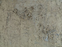 Gray cracked paint on an old wall Royalty Free Stock Photos