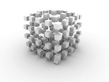 Gray cube. Big monochrome gray cube made of smaller cubes in process of destruction on white background Royalty Free Stock Photo