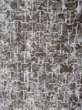 Gray cube pavement sprinkled with snow Stock Photos