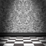 Gray Damask Wallpaper With Gray & White Checkerboard Tile Floor. Dramatic room with silver-gray flocked damask wallpaper and gray and white checkerboard floor Royalty Free Stock Photography