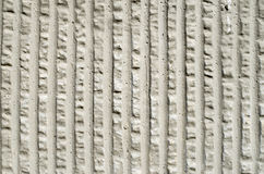 Gray decorative relief plaster on wall Royalty Free Stock Photography