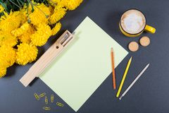 Gray desk surface with sheet of paper, color pencils, wooden pen royalty free stock images