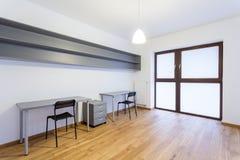 Gray desks in empty interior Stock Photos