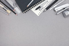 Gray desktop with notebook, pencils and various drawing tools, t Stock Photo