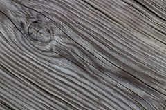 Gray diagonal wood grain and a knot Stock Photography
