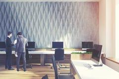 Gray diamond wall pattern open office, men Stock Photo