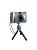 Gray digital photo camera on tripod isolated over white Stock Photo