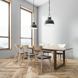 Gray dining room corner. Corner of dining room with gray walls, wooden floor, wooden table with gray and wooden chairs and two ceiling lamps. 3d rendering royalty free illustration