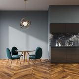 Gray dining room interior, blue chairs. Gray wall dining room and kitchen interior with a wooden floor, a round table and blue chairs. 3d rendering mock up Royalty Free Stock Images