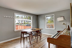 Gray dining room interior with piano Royalty Free Stock Image