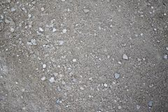 Gray Dirt and Stone Texture. RnBackground or texture. monochrome rocks and sand royalty free stock photos