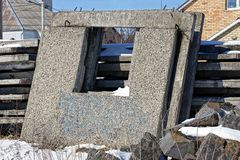 Gray concrete blocks with a window frame on a building site in the snow royalty free stock photo