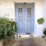 Gray door and flowerpot. Door and flowerpot, Anafiotika, Athens Greece royalty free stock image