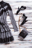 Gray dress and black bag. Stock Images