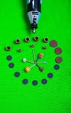 A gray drill with drilling accessories on green background aerial view Royalty Free Stock Photos