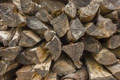 A gray dry logs of firewood in the stack. natural surface texture. Gray dry logs of firewood in the stack. natural surface texture royalty free stock photo