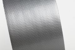 Gray Duct Tape. Silver repair duct tape with white background royalty free stock photo