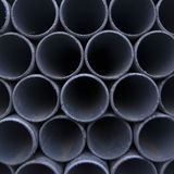 Gray dusty pipes stacked in construction site Stock Images