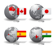 Gray Earth globes with designation of Canada, Japan, Spain and India Stock Photos