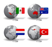Gray Earth globes with designation of Mexico, Australia, Netherlands and Turkey Stock Images