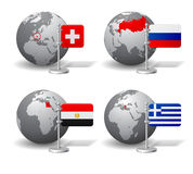 Gray Earth globes with designation of Switzerland, Russia, Egypt Royalty Free Stock Photography