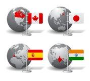Gray Earth-Kugeln mit Bezeichnung von Kanada, von Japan, von Spanien und von Indien Stockfotos