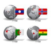 Gray Earth-Kugeln mit Bezeichnung von Laos, Norwegen, Algerien und Lizenzfreie Stockfotografie