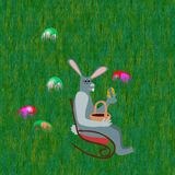 Gray easter rabbit with egg on chair on lawn Royalty Free Stock Photo