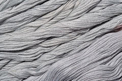 Gray embroidery floss as background texture Stock Images