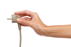 Gray european electric plug in female hand Stock Photography