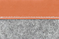 Gray fabric and brown leather background Royalty Free Stock Image