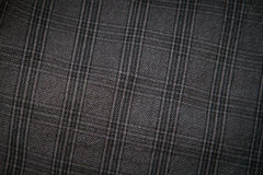 Gray fabric in a cage close up Royalty Free Stock Photos