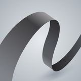 Gray fabric curved ribbon on grey background Stock Image
