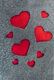 Gray felt fabric with red hearts. Symbols. Handmade royalty free stock photo