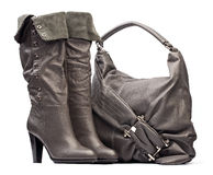 Gray female high-heeled boots and bag Stock Photo