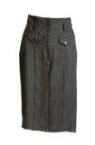 Gray feminine skirt with button. On white background royalty free stock photos
