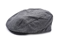 Gray flat cap. A gray flat cap on a white background royalty free stock photos