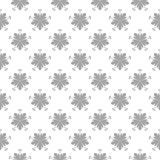 Gray floral ornamental design on white. Seamless backround. Light gray floral ornamental design on white. Seamless pattern for textile and wallpapers Royalty Free Stock Photography